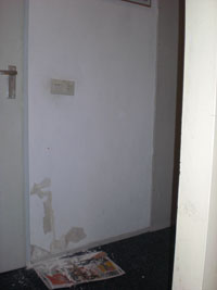 muur met afgebladderde verf